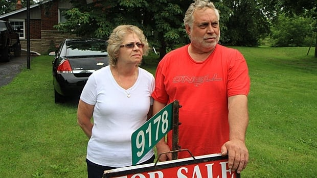 Gerry and Sue Schneider are among a new group of six homeowners who want the city to buy their land. They're asking in light of a new airport expansion they say will put jet planes too close to their homes. The city is examining two other locations for the new cargo terminal.