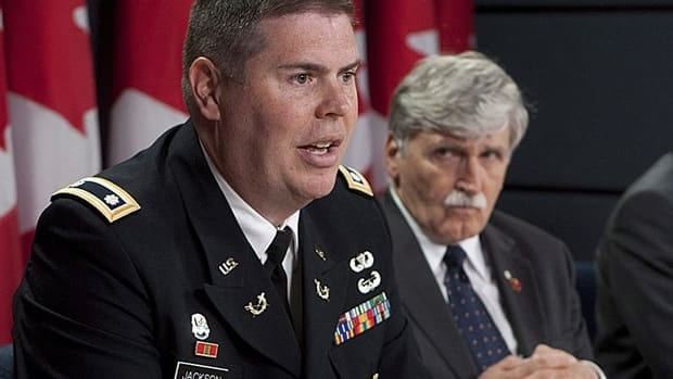 Senator Romeo Dallaire looks on as Omar Khadr's Pentagon-appointed lawyer, Lt.-Col. Jon Jackson, speaks in Ottawa June 21.