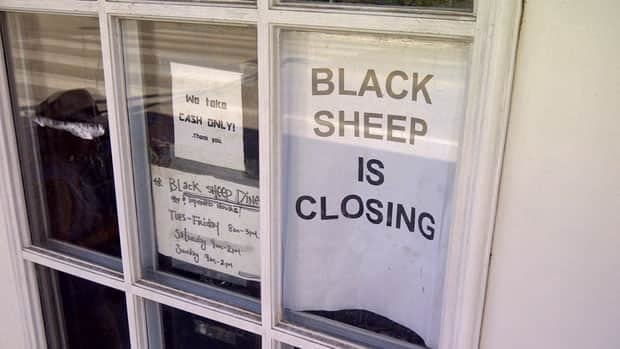 A sign on the door of the Black Sheep Diner on Sunday, hours before the Ellice Avenue restaurant closed down.