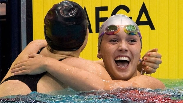 Hamilton swimmer Summer Mortimer, shown at right in this April 2012 file photo, captured gold at the Paralympic Games in London on Friday.