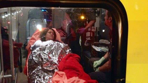 Manolo Ambrosio De Leon's wife and baby are loaded into an ambulance on Highway 40 this morning.