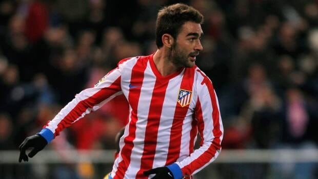 Atletico de Madrid's Adrian Lopez scored the lone goal in his team's 1-0 win over Celta Vigo on Friday.