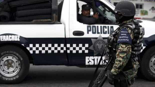 Two U.S. Embassy employees were hospitalized after Mexican federal police opened fire on the Americans' sport utility vehicle on a road south of Mexico City.