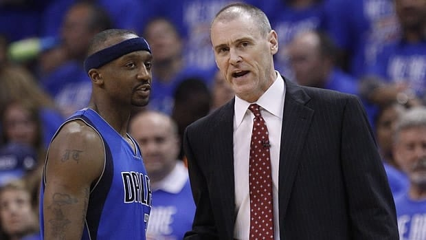 Dallas Mavericks head coach Rick Carlisle (right), talks with Jason Terry (right), in Game 1 of the first round of the NBA playoffs.
