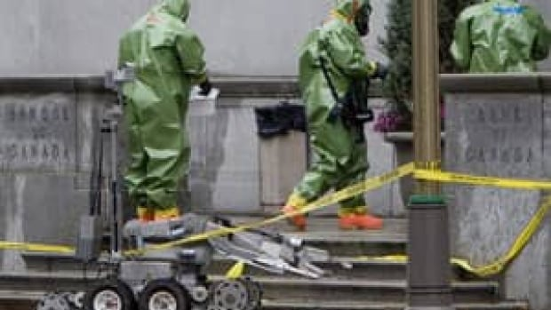 Members of the bomb squad wearing hazardous materials suits investigate suspicious packages in Ottawa in 2008. RCMP data show police dealt with nearly 1,000 incidents involving criminal use of explosives from 2008 to 2012.