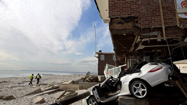 A damaged home in Queens, New York, in the wake of Superstorm Sandy which left more than 100 people dead in the U.S.