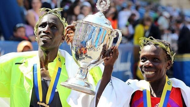 Wesley Korir of Kenya, left, celebrates his Boston Marathon victory with winner of the women's race, Sharon Cherop on Monday.