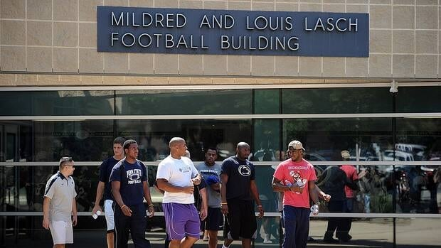 Penn State football players leave the Mildred and Louis Lasch Football Building following a team meeting soon after the NCAA announced Sanctions on July 23, 2012.