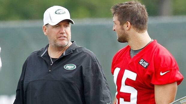New York Jets head coach Rex Ryan, left, defended quarterback Tim Tebow, right, from comments made anonymously by teammates in a newspaper report.