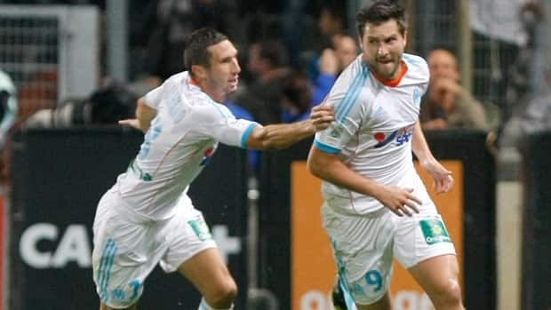 Marseille's French forward Andre-Pierre Gignac, right, reacts with midfielder Morgan Amalfitano, after scoring against Paris Saint-Germain on Sunday.