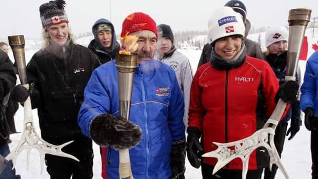 Olympic cross-country skier Sharon Firth, right, is one of 13 people being inducted into the N.W.T. Sport Hall of Fame on Friday. She was one of the torch bearers for the 2007 Canada Winter Games along with Olympian Lucy Steele-Mason of the Yukon, left, and John Taipana of Nunavut, centre.