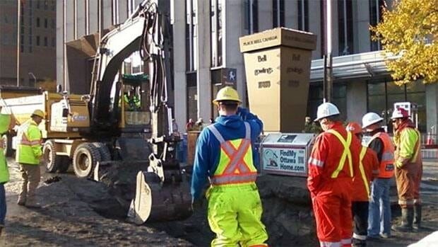 City crews repair a sinkhole on Elgin Street after a water main broke early Friday morning.