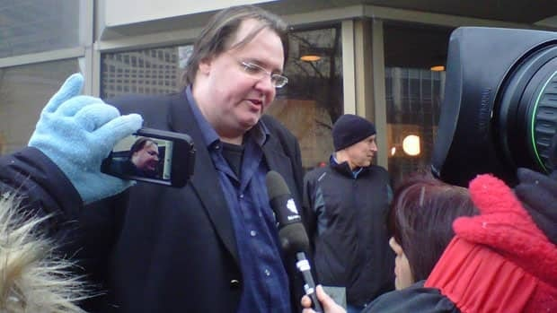 Greg Gilhooly speaks to reporters outside court in Winnipeg on Feb. 22, ahead of the Graham James sentencing hearing.