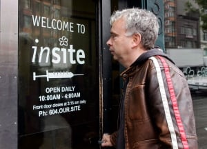 Mark Townsend, manager of the Portland Hotel Society, enters Insite