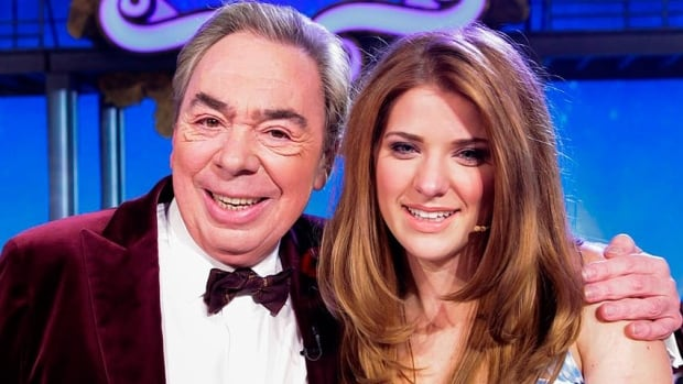 Theatre impresario Andrew Lloyd Webber poses with his newest Dorothy, 20-year-old Over the Rainbow winner Danielle Wade, in Toronto on Monday.