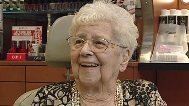 Viola Arnold, 100, is all smiles after finally getting her ears pierced.