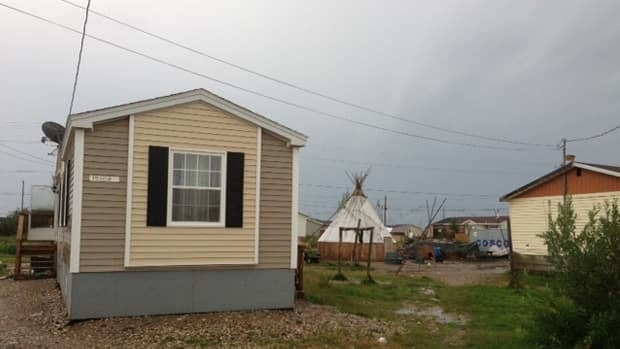 Although the band says the First Nation of Attawapiskat is making progress on the housing, familes still in temporary housing are far less optimistic.