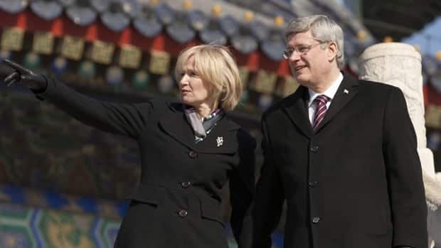 Canadian Prime Minister Stephen Harper and his wife Laureen tour the Temple of Heaven in Beijing on Wednesday. Harper, who is on a five-day trip to China, helped launch a new tourism marketing campaign highlighting the centennial of the Calgary Stampede as a reason for more Chinese to travel to Canada.
