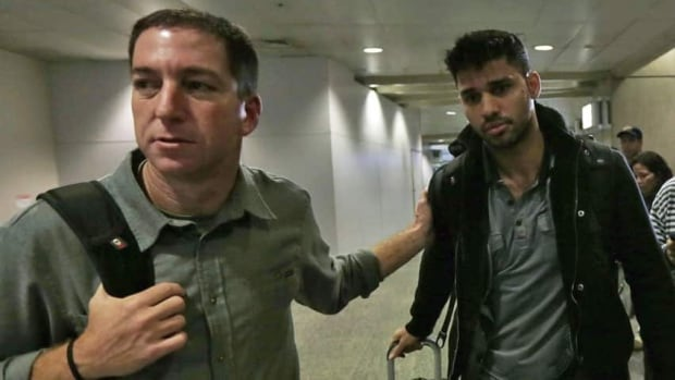 London police detained David Miranda, right, the partner of reporter Glenn Greenwald, left, under anti-terror legislation at the London airport on Sunday. Miranda arrived Monday in Rio de Janeiro, where he lives with Greenwald.