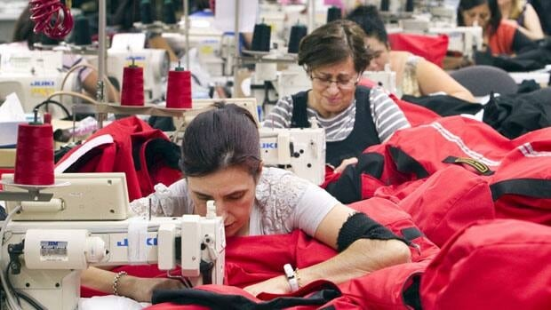 Workers piece together outerwear on the manufacturing floor of Canada Goose's facility in Toronto on Jan. 17.