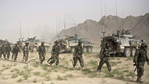 Afghan Army soldiers arrive to join a mission with Canadian soldiers with the 1st Battalion, in Khebari Ghar in the Panjwayi district, south-west of Kandahar, Afghanistan on June 3, 2010.