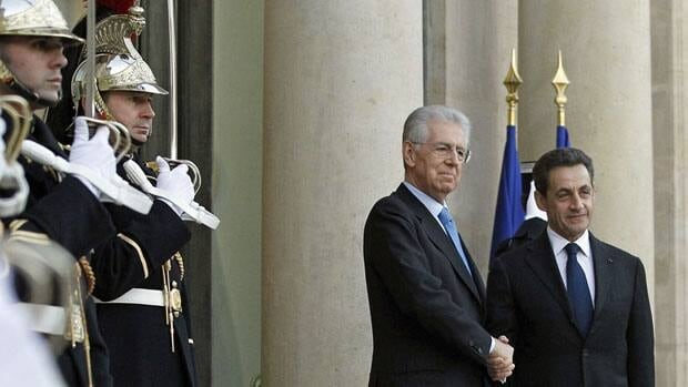 The euro reached new lows Friday amid grim economic news as French President Nicolas Sarkozy, right, greeted Italian Prime Minister Mario Monti prior to their meeting at the Elysee Palace in Paris.