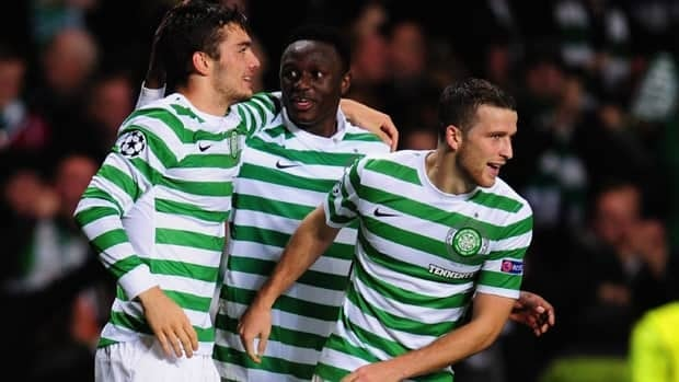 Celtic player Tom Watt, left, celebrates his goal with Victor Wanyama, centre, and Adam Matthews during the Group G match in Glasgow on Wednesday.