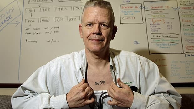 Pathologist Dr. Ed Friedlander displays his tattoo with a medical directive to not use CPR, which appears to be a growing trend in North America.