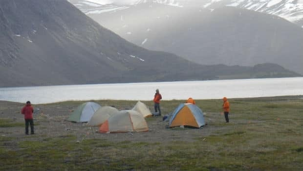 A U.S. hiker was sleeping when a fellow traveller was attacked during a visit to Torngat Mountains National Park in northern Labrador. He is now calling for changes to Parks Canada safety policies.
