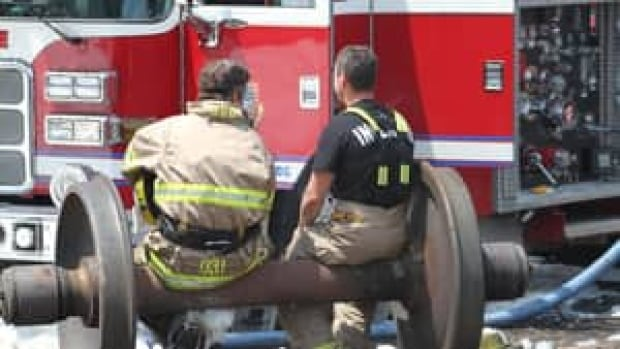 sq-image-firefighters-sit-852-4col