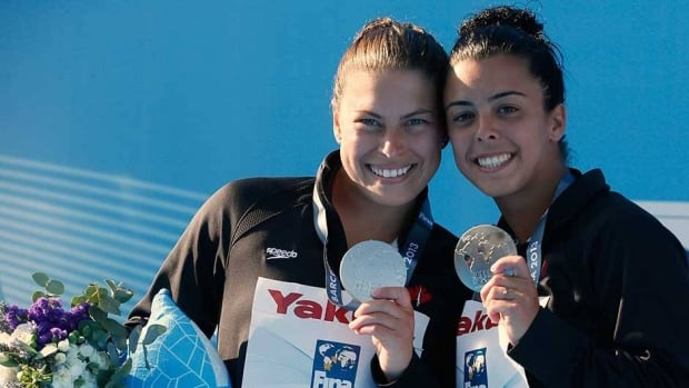 Canada's Meaghan Benfeito, right, and Roseline Filion pose with their silver medals at the women's synchronised 10m platform final at the Montjuic municipal pool in Barcelona on Monday.