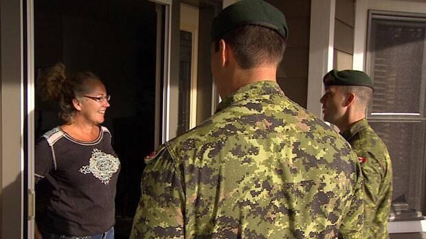 Whitehorse homeowner Suzanne McDonald greets soldiers on her doorstep as part of an Op Nanook evacuation drill.
