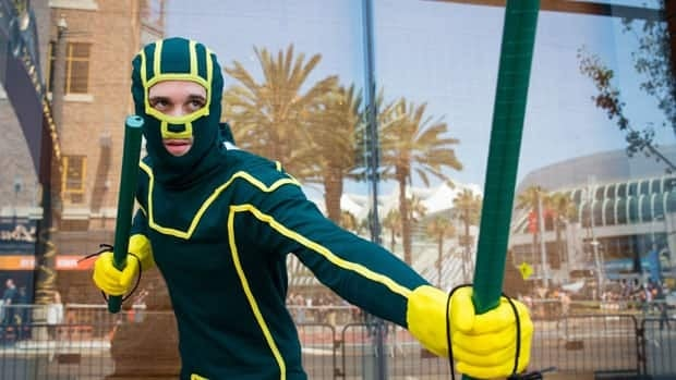 Cosplayer Travis Stapleton dressed as a comic book character for the 2013 San Diego Comic-Con International, which celebrates comics and related pop culture.