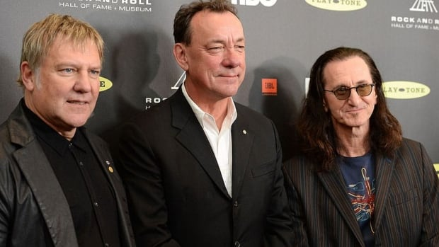 Iconic power rock trio Rush, featuring (from left) Alex Lifeson, Neil Peart and Geddy Lee, raised more than $500,000 for Alberta flood relief from their July 24 benefit concert in Red Deer.