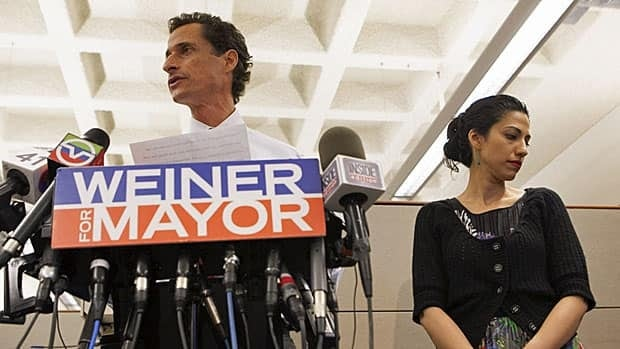 New York mayoral candidate Anthony Weiner and his wife Huma Abedin at a press conference on July 23 when he admitted that he had sent more sexually explicit chats and photos of himself after he had resigned from Congress.