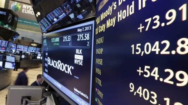 A board on a trading post on the floor of the New York Stock Exchange shows the Dow Jones industrial average as it rises above 15,000 on May 7. The basket of stocks reflecting the average will be juggled on Sept. 23.