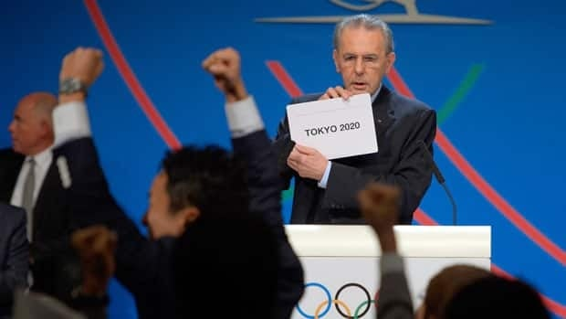 Members of Japan's delegation celebrate as International Olympic Committee President Jacques Rogge reveals Tokyo as the host city of the 2020 Summer Olympics Saturday.