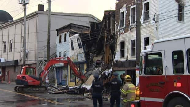 Police and fire crews examine the rubble left behind from the downtown St. John's fire of Sept. 4, 2013.