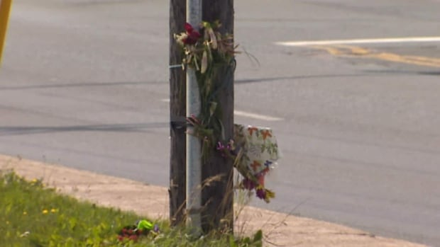 Friends and family placed flowers at the end of Polina Road following the fatal crash.