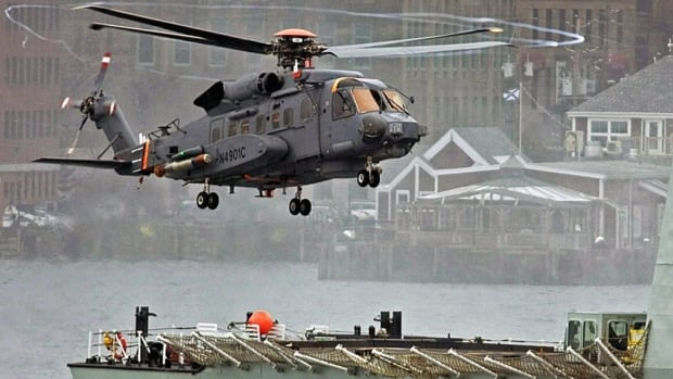 A Canadian military Sikorsky CH-148 Cyclone conducts test flights with HMCS Montréal in Halifax Harbour on April 1, 2010.