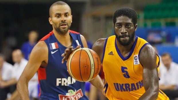 Ukraine's Eugene Jeter, right, challenges for the ball with France's Tony Parker, during their EuroBasket European Basketball Championship Group A match in Ljubljana, Slovenia on Sunday.