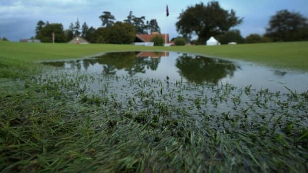 Large rain puddles make the 18th green unplayable in Evian-les-Bains, France, on Thursday.