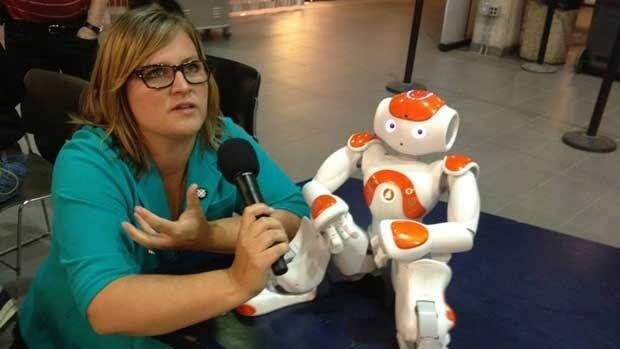 Information Radio host Marcy Markusa spends some time with Nao, a robot programmed by University of Manitoba researchers to be a 'bossy bot.' The show was broadcast live from the university campus on Thursday.