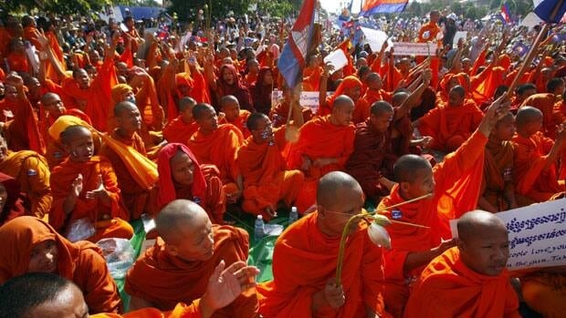 Cambodian Buddhist monks participated in a demonstration in Phnom Penh, Cambodia, Saturday. More than 10,000 opposition supporters gathered in the nation's capital to demand an investigation into alleged election fraud.