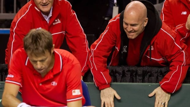 Racquet stringer and technical consultant Yvon Gilbert, right, is seen here cheering on Canada's Daniel Nestor and Vasek Pospisil during their match against Spain's Marcel Granollers and Marc Lopez at a Davis Cup tennis world group first-round tie doubles match in Vancouver on February 2. Gilbert has been with Team Canada during its ups and downs.