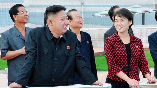 North Korean leader Kim Jong-Un (2nd L) and his wife (red),  Ri Sol, have a baby daughter, according to former basketball star Dennis Rodman.
