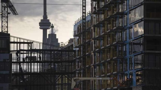 Some analysts think condo markets in cities like Toronto, above, and Vancouver are overbuilt but that the surplus units will be absorbed by increasing demand from immigrants, retirees and people under 35.