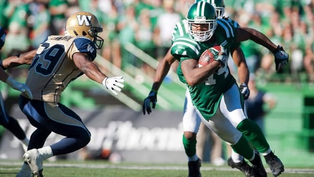 Saskatchewan Roughriders defensive back Prince Miller runs the ball past Winnipeg Blue Bombers slotback Clarence Denmark last week in a Riders dominant victory over the Bombers.
