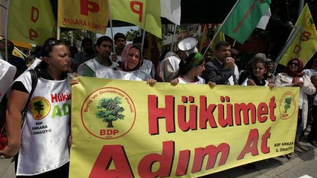 Kurds protest in Turkey in July 2013. Kurdish rebels stopped their withdrawal from Turkey, according to local reports.