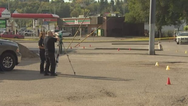 Investigators survey evidence at the parking lot where Broussie was found unconscious September 9.